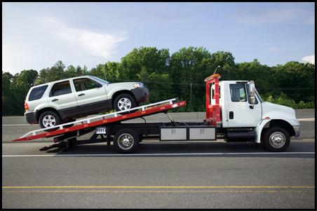 Car on the back of a tow truck