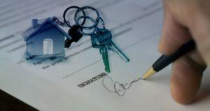 Signing closing documents with house keychain