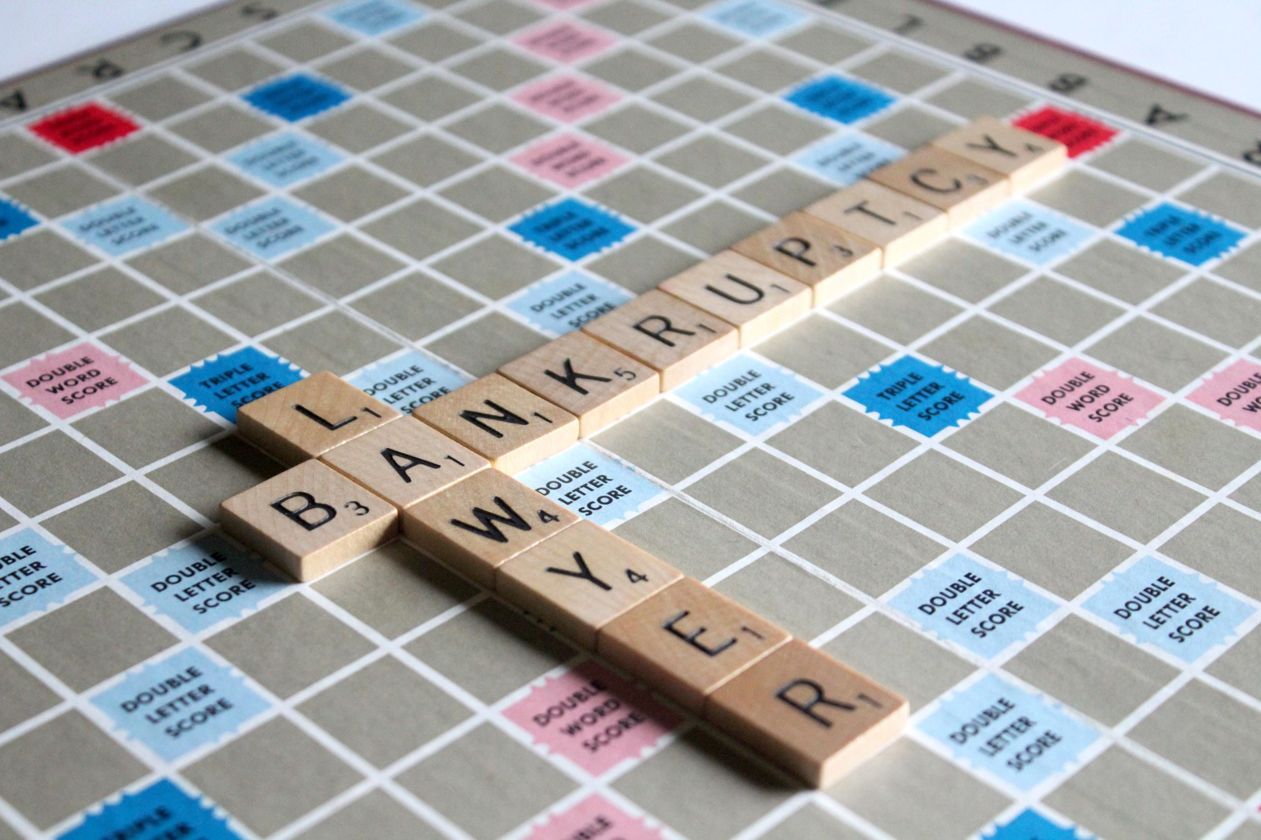 Scrabble Board with tiles spelling out Bankruptcy Lawyer