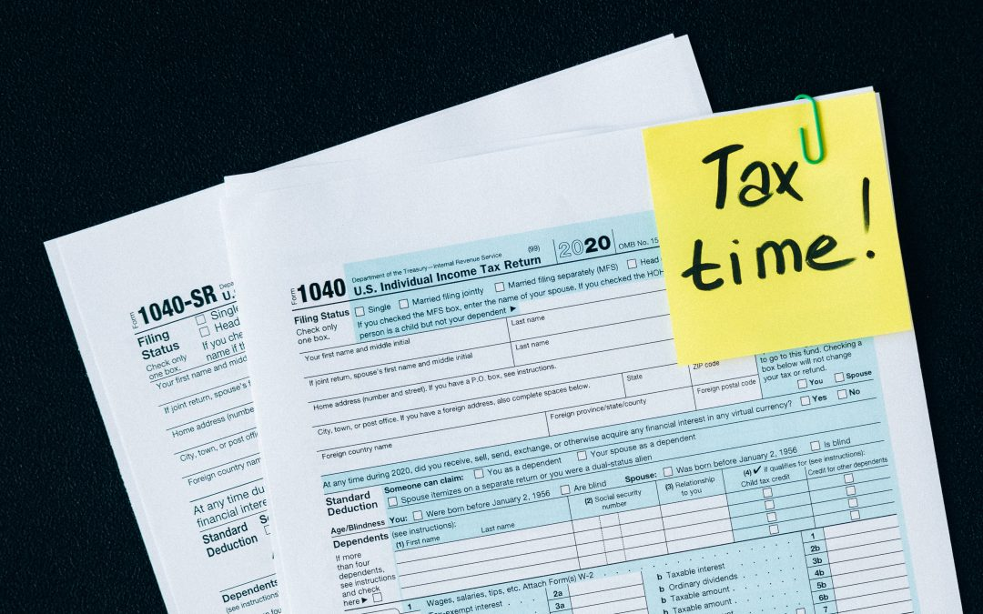 2020 Tax forms with reminder sticky note